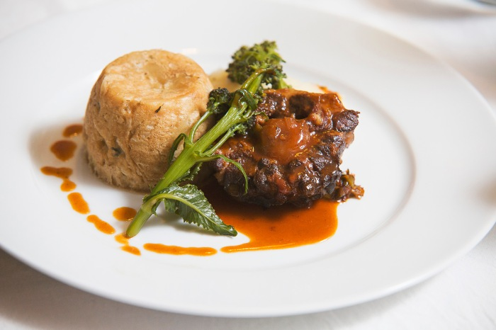 Brasied oxtails with an individual bacon and leek suet pudding, celeriac mash and seasonal vegetables